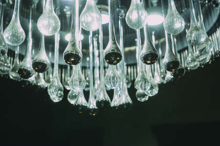 chandelier of light bulbs on a black background. isolated. Lighting decor Stock Photo - 100439509
