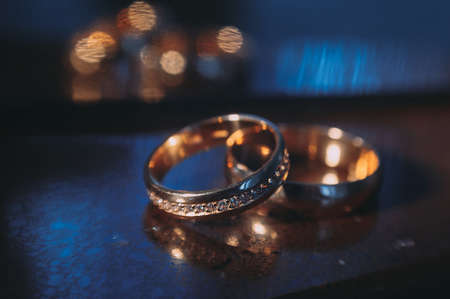 beautiful golden wedding rings on sparkling background Stock Photo