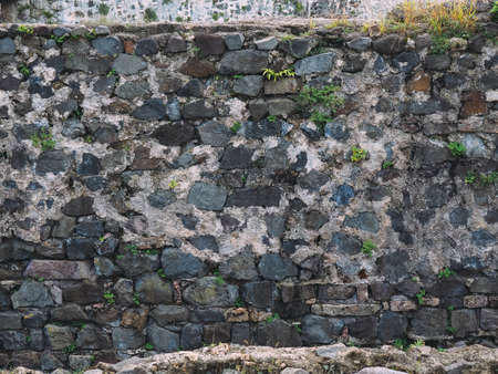 stone wall texture with cracks and patterns on the surface