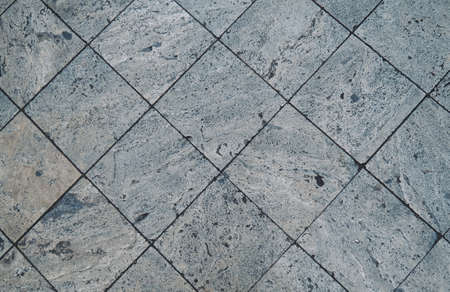 Stone pattern on tile floor with grid line for background. 版權商用圖片