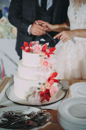 White wedding cake with flowers and blueberries