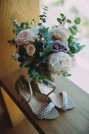 beautiful shoes of the bride. Wedding accessories. Stock Photo