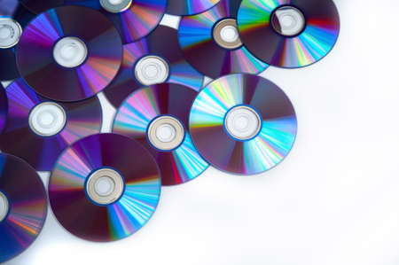 Bunch of cd discs on a white background