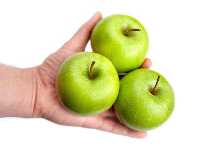 three ripe green apples in hand on white background Zdjęcie Seryjne - 124145859