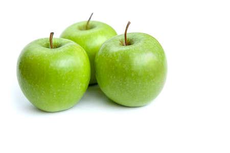 three green apples on white background Zdjęcie Seryjne