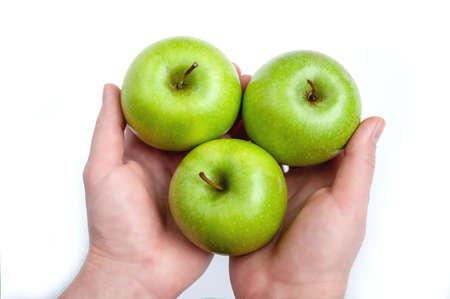 three ripe green apples in hand on white background Zdjęcie Seryjne - 124145870