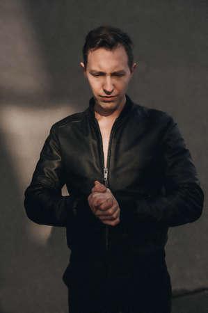 Stylish fashion young Man portrait with leather jacket on black background Zdjęcie Seryjne - 124145879