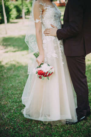 bride and groom with a wedding bouquet. photo shoot walk close-up Stock Photo