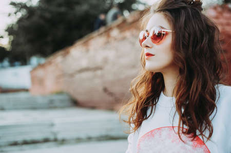 Portrait of a young nice-looking girl in red glasses. life style