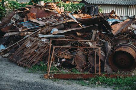 a pile of rusty scrap metal. garbage