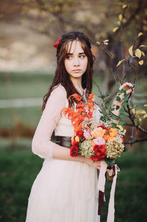 Beautiful young bride with a wedding bouquet of flowers. flowers in hair