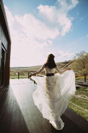 beautiful bride posing at the morning training camp. flying dress