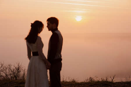 beautiful romantic couple at sunset close-up. love. emotions. parting. frame from the movie. book cover