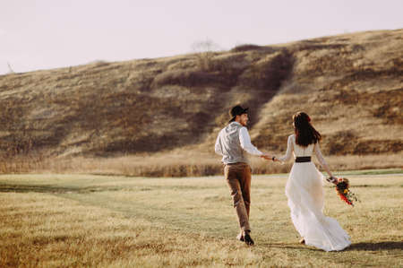 Beautiful stylish Asians bride and groom in alpine meadows in Italy, Trentino Alto Adige