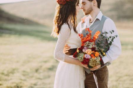 wedding. beautiful couple kissing in the sun Stock fotó