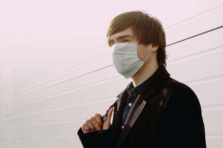 Guy in a protective medical mask. coronavirus. epidemic. virus protection.Global epidemic.