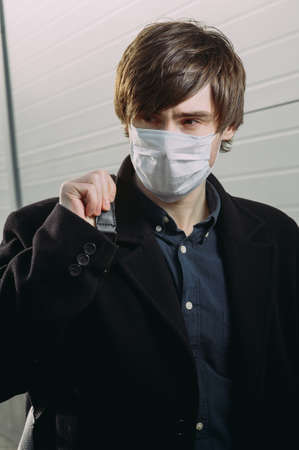 Guy in a protective medical mask. coronavirus. epidemic. virus protection. Archivio Fotografico