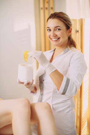Sugaring: epilation with liquate sugar at legs.