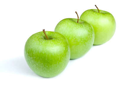 Three ripe green apples on a white background. isolated
