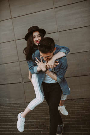 Beautiful and stylish guy and girl are having fun in the park. smiling and having fun Zdjęcie Seryjne