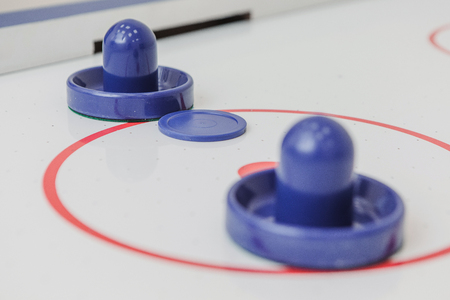 Blue pieces of a toy table hockey game