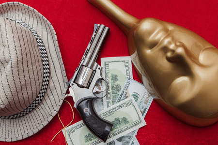 Gun and money with a mask and hat, mafia game