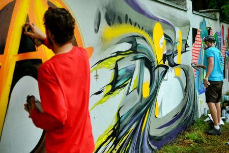 Graffiti on a fence.