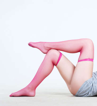 Beauty legs of young woman in stockings at white background Stock Photo - 3632709