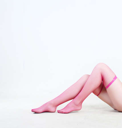 Beauty legs of young woman in stockings at white background Stock Photo - 3727191