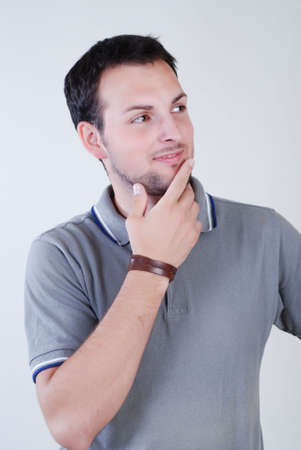 young fellow: Portrait of young fellow dressed in a grey sport shirt