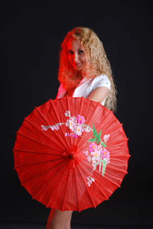 Portrait of young beauty woman in white dress at black background with umbrella Stock Photo - 3732727