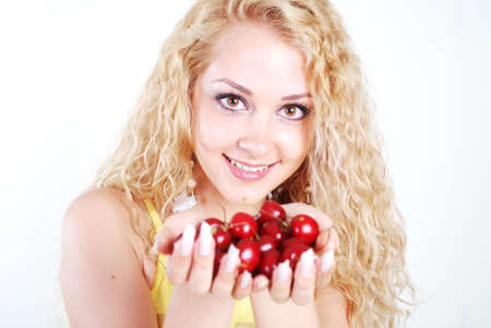 Beauty woman with red cherry in hands at white background photo