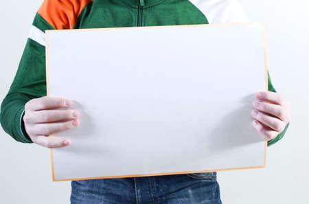 Man takes placard at white background Stock Photo - 3821882