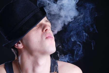 Young man smokes big cigar photo