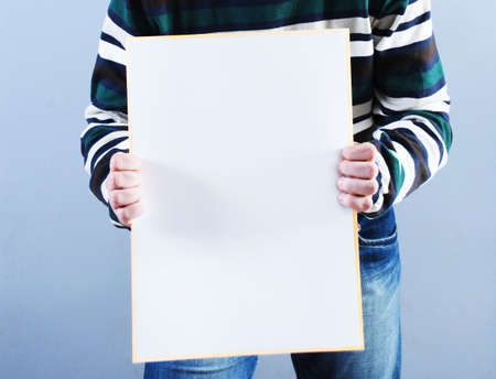 Man takes placard at blue background Stock Photo - 3821947