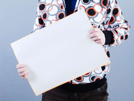 Man takes placard at blue background Stock Photo - 3821946