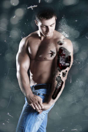 athletic cyborg with injuries in his arm Stock Photo