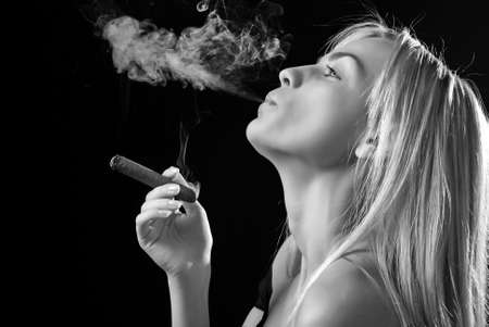 portrait of smoker beautiful young woman with cigar