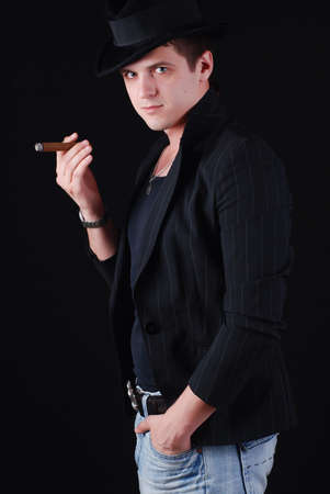 portrait of young gangster in black suit with cigar photo