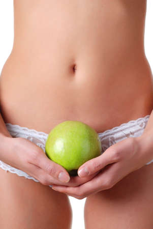 beautiful female stomach and apple in hand photo