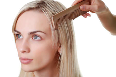 beautiful woman with blond long hair and wood comb Stock Photo - 4059725