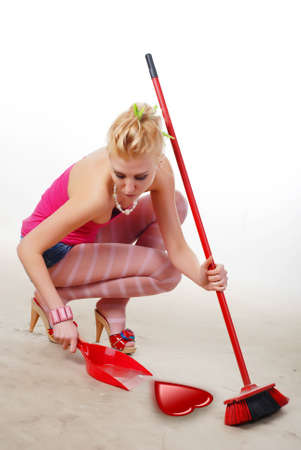 beautiful glamour woman sweeping heart with broom Stock Photo - 4113836