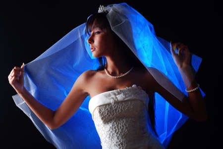 portrait of a young beautiful bride with dark hair photo