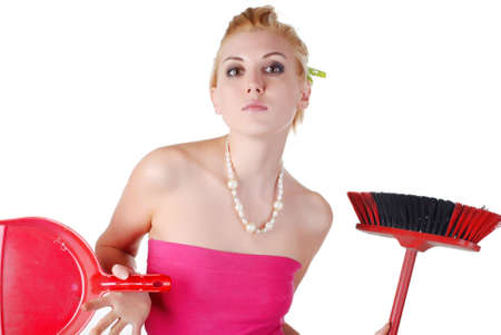 portrait of young beautiful housewife with dustpan and broom Stock Photo - 4165354