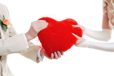 shaped hands: picture of loving couple with red heart in their hands Stock Photo