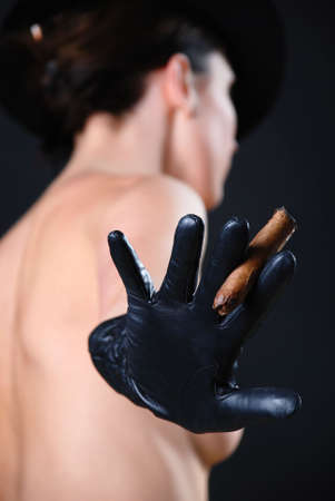 bare girl: Bare girl in black gloves and a cigar in a hand