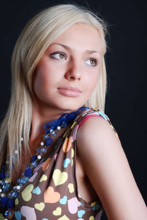 The beautiful girl in a sundress with a beads on a neck and a bracelet on a hand photo