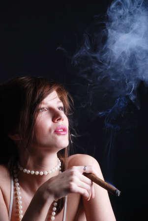Smoking woman and smoke from mouth photo