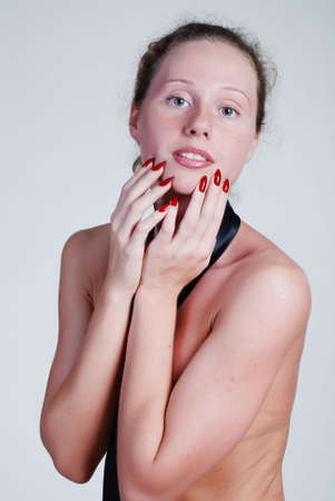 naked young girl: A naked young girl is in a black tie, covers hands a breast Stock Photo