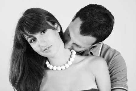 Two falling in love. He hugs it, and kisses in a shoulder Stock Photo - 4214504